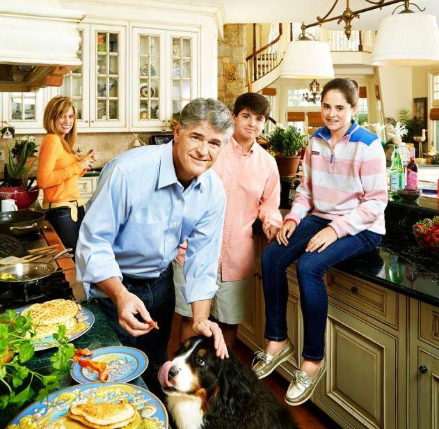 Jill Rhodes with her husband Sean & kids inside their house