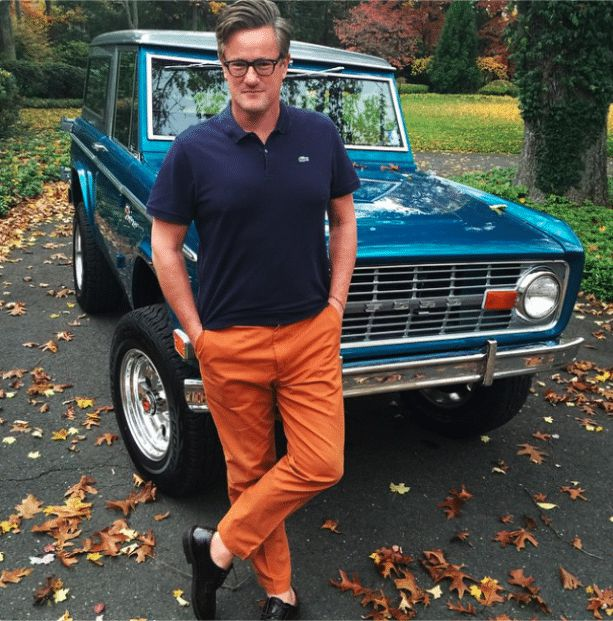 Waren's ex-husband Joe posing for photo with his classic car