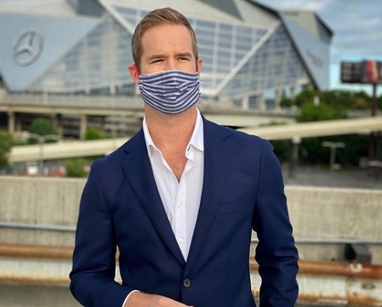 Morgan Chesky reporting while wearing mask