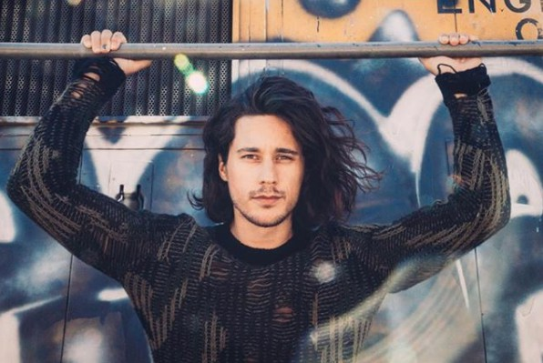 Actor Peter Gadiot posing for a photo