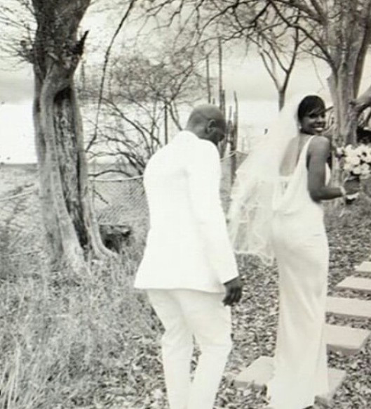 Tim Weatherspoon with his wife Kelly in their wedding dress