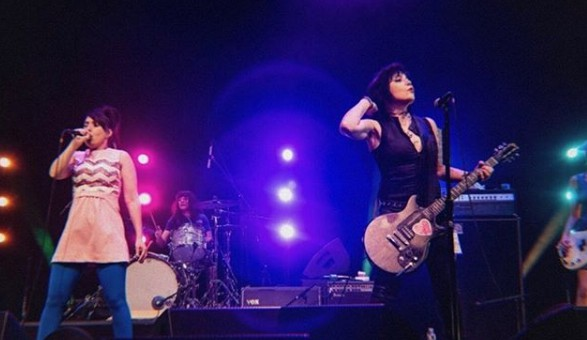Joan Jett signing song with her band