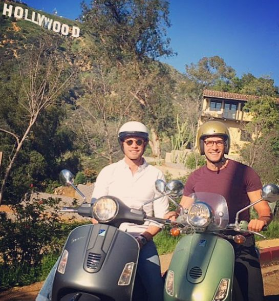 Jacob Jules Villere driving scooter with his partner Peter