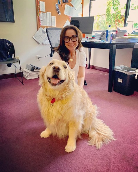 Marney Hochman posing for a photo with her dog