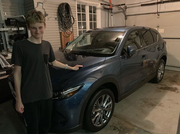 Evan Joseph Asher clicking photo with his new car