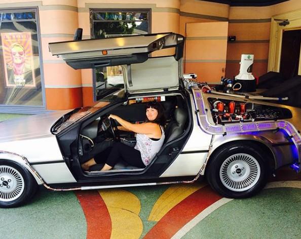 Ellen Hamilton Latzen posing for the picture with her car