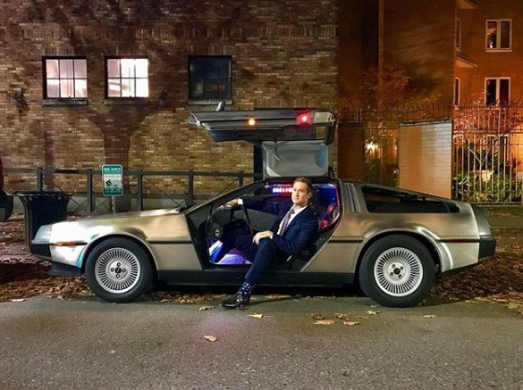 Morgan Chesky posing for a picture sitting in the classic car