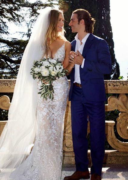 Sean Edward Hartman's sister Birgen with her husband in their wedding dress
