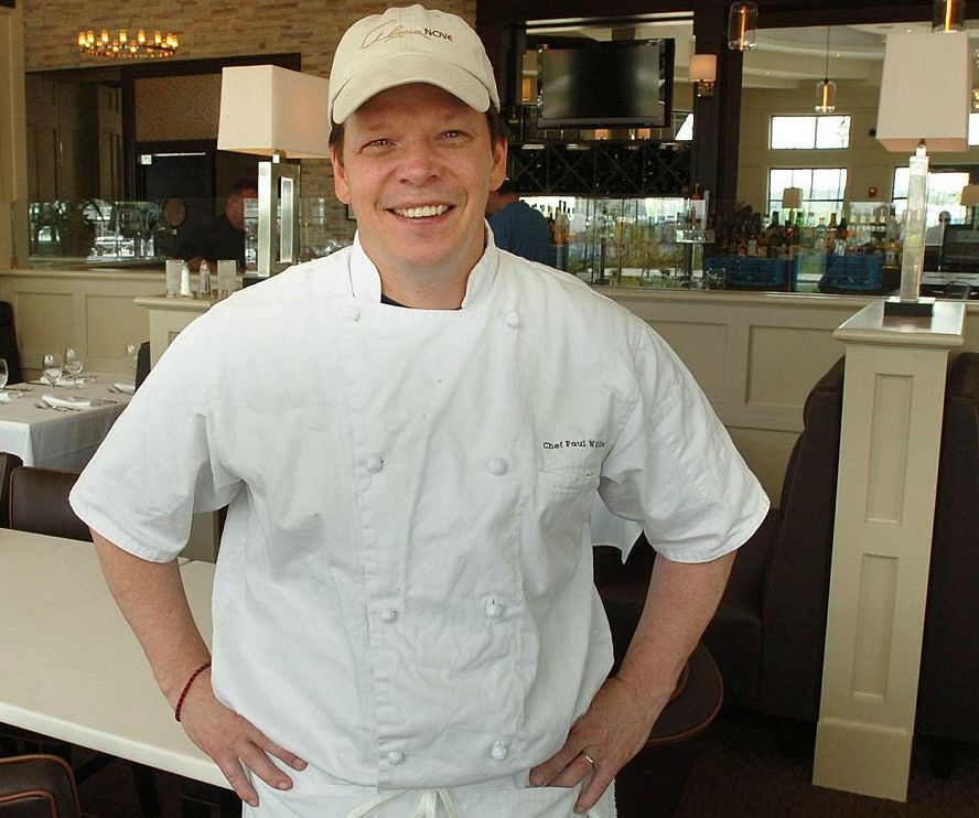 Paul Wahlberg posing for a picture in his chef dress