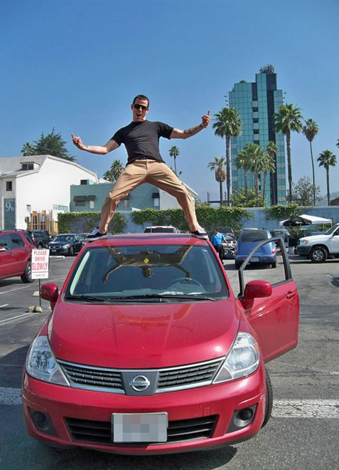 Candy Jane Tucker's ex-husband Steve-O posing for photo with standing in the top of car