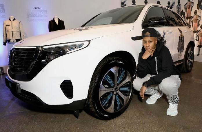 Lena Waithe posing for photo with her car