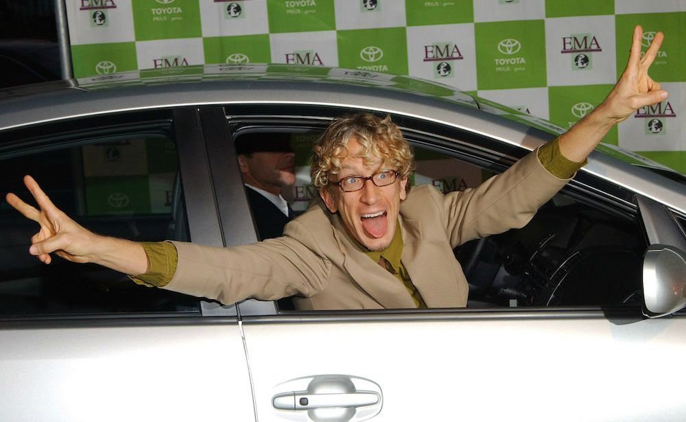Lena Sved's husband Andy posing for the picture sitting inside his car