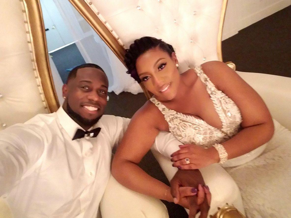 Derrick Jaxn clicking selfie with his wife Da'Naia in their wedding dress