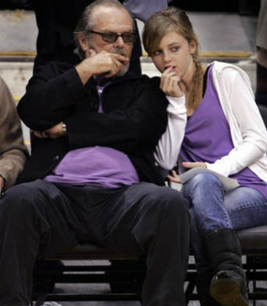 Honey Hollman watching the game sitting with her father