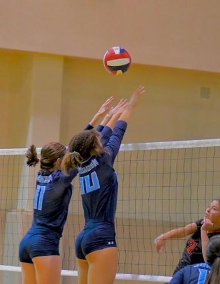 Devyn Winkler playing volleyball