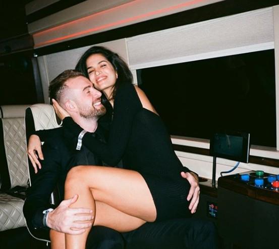 Chris Pfaff hugging his girlfriend Koreen Odiney