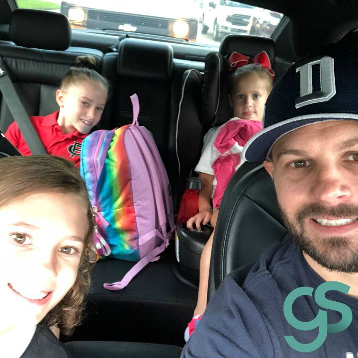 Gabriel Swaggart clicking selfie sitting inside his car with his daughters