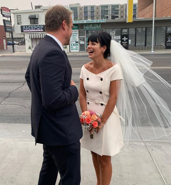 Lily Allen with her husband David Harbour in their wedding dress
