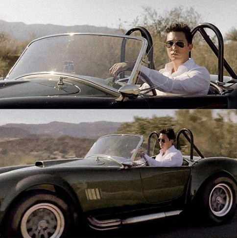 Daniel Henney driving the classic car