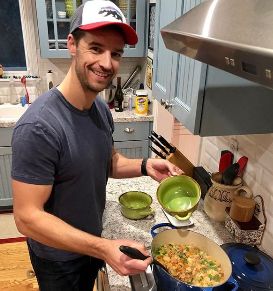 Joshua Snyder cooking the food