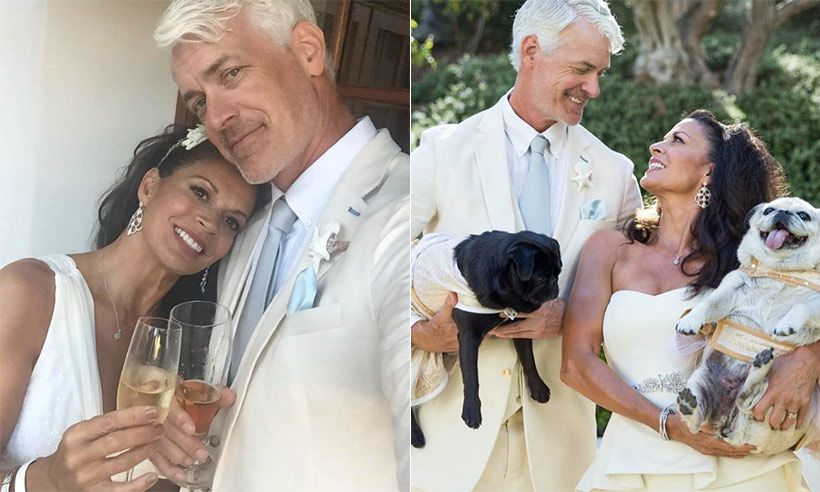 Dina Eastwood with her current husband Scott Fisher in their wedding dress