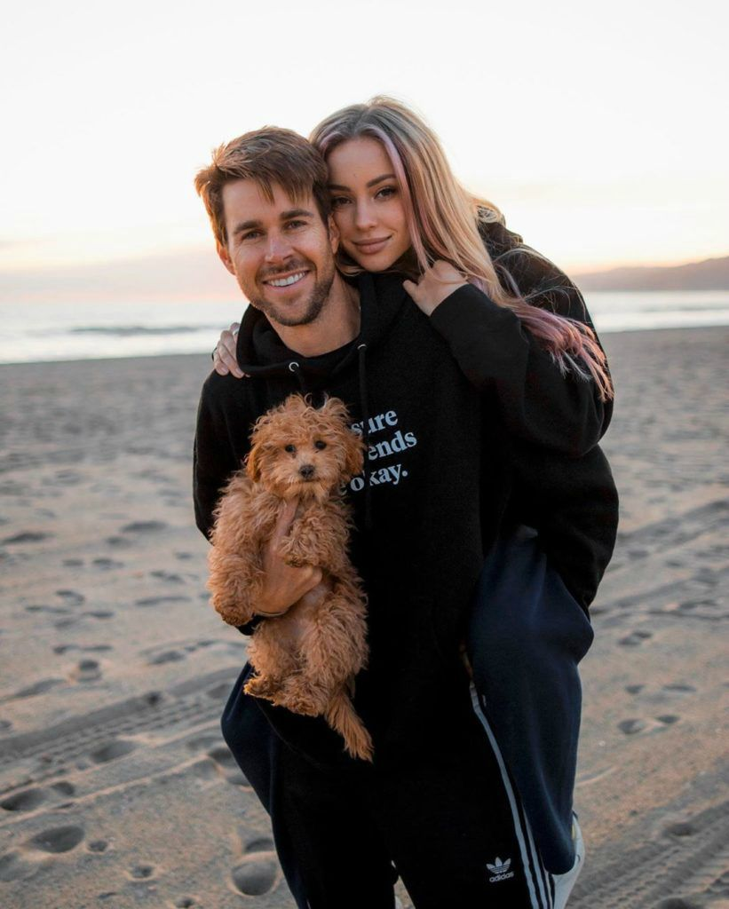 Charly Jordan's boyfriend Robert carrying her and a dog