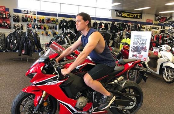 Chai Hansen sitting in the bike