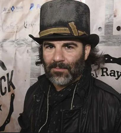 Actor, Singer John M. Cusimano with with wearing hat