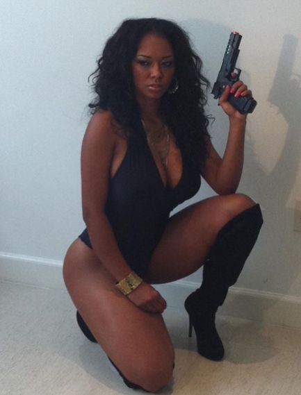 Esther Baxter posing for picture with gun
