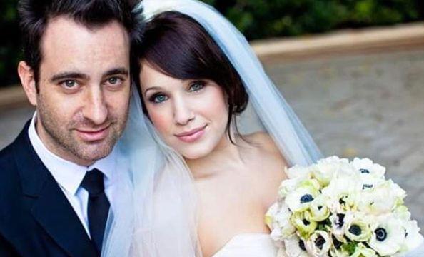 Marla Sokoloff with her husband in their wedding dress