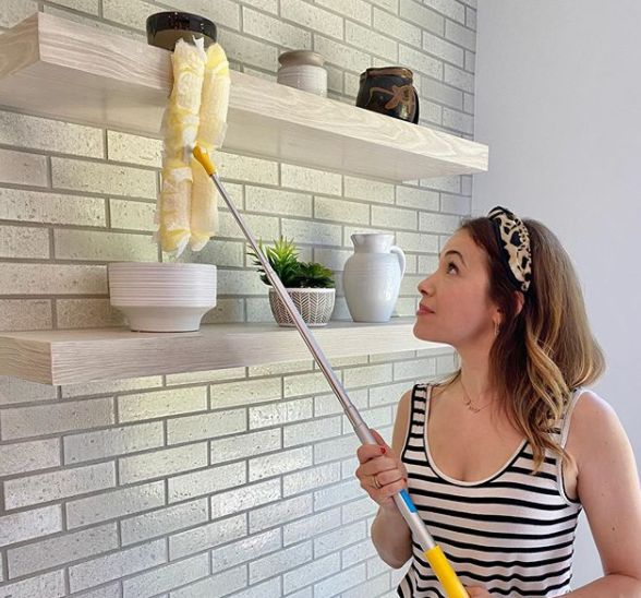 Marla Sokoloff cleaning her house