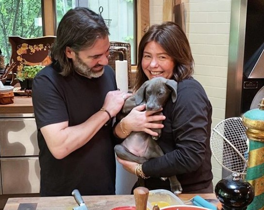 John M. Cusimano with his wife Rachel and their dog