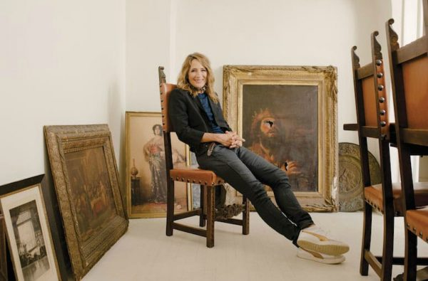 Anne Ramsay posing for a picture sitting on the chair