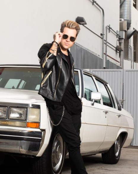 Ryan Cabrera posing for photo with car in the background