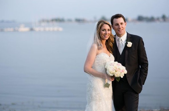 Todd Piro with his wife Amanda Raus in their wedding dress