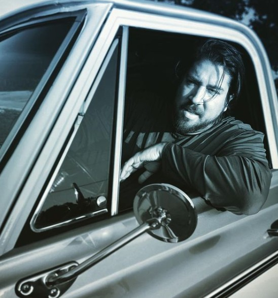 Tanner Beard sitting insider the car