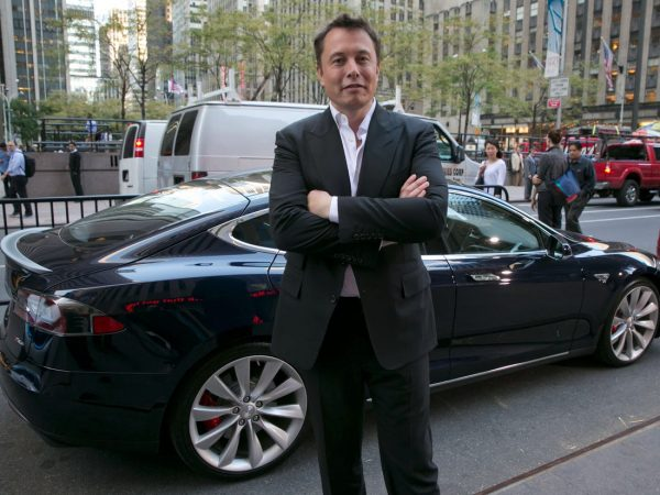 Musk with car in the background