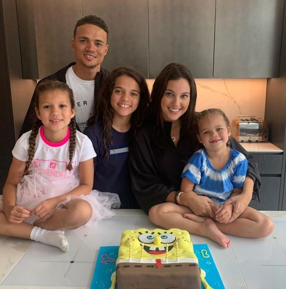 Ellie Penfold with her husband Jermaine and their daughters
