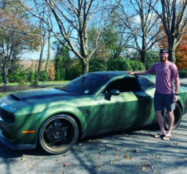 Madison husband Carson Wentz posing with his car