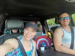 Caption : Kelsey McEwen ,her husband and their kids inside their car