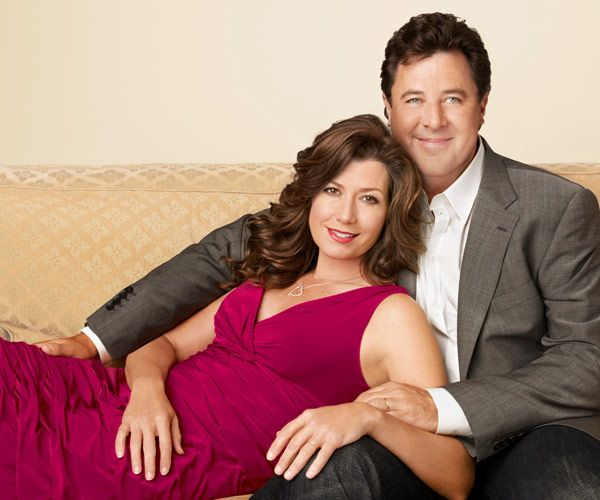 Caption: Vince Gill and his wife Amy Grant posing for the Photo