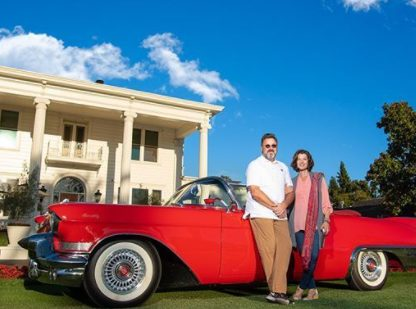 Caption :Corrina Grant Gill's father and mother posing for the photo with car