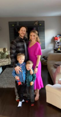 Kelsey McEwen posing for the photo with her husband and kids