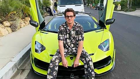 Caption: Charlie Puth with his car