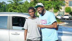 Rickey Smiley and his friend with his car