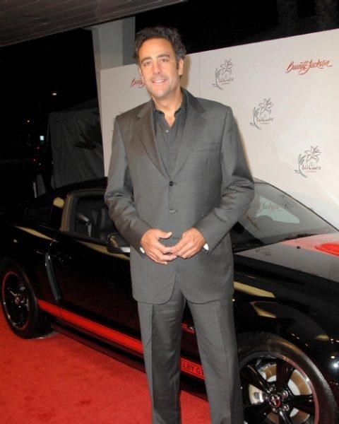 Brad Garrett with the car