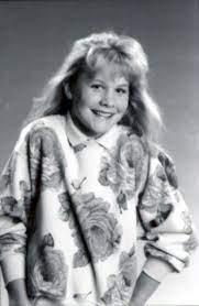 Caption :Josie Davis's childhood photo