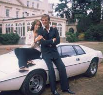 Barbara Bach posing for a photo with car
