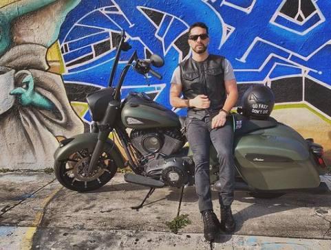 Bayardo de Murguia posing with his motorbike
