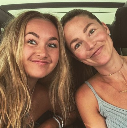 Allie LaForce with one of her co-workers in her car